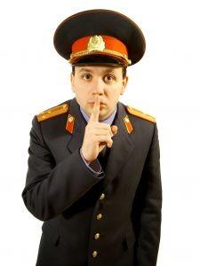 police officer shushing